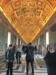 The hallway on the way to Sistine Chapel's ceilings lined with paintings