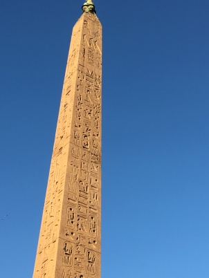 An authentic Egyptian obelisk in the center of Piazza Popoli