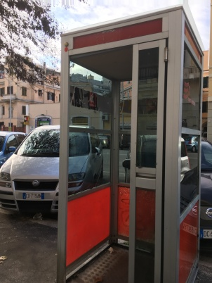 Amongst the Roman relics of the past, a phonebooth!