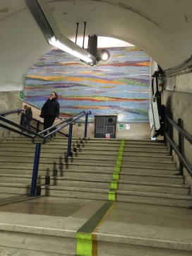 a cool wall mural in one of the metro subway stations
