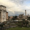 A storm coming in over the Roman Forum ruins, with a tiny spot of rainbow if you look closely