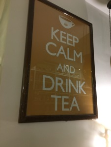 A sign in a tea shop