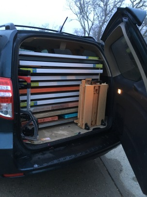 That's wet paintings along with blank canvases in the cool custom canvas rack of my SUV