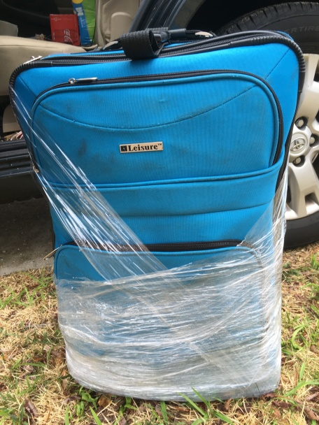 On my last residency the bottom corner of this suitcase got a hole, but we didn't have duct tape, so we used the next-best thing -- shrink wrap!