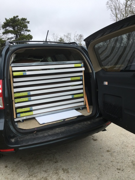 My cool custom SUV painting storage travel rack, full of new blank canvases