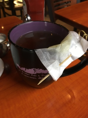 "They keep the loose-leaf teabag affixed to the mug using a ""sword"""