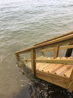 Stairs to ocean at high tide