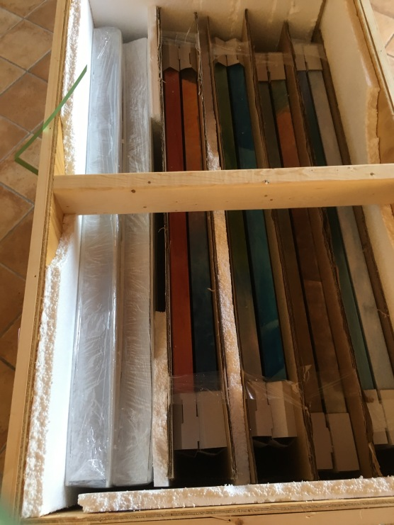 How some of the paintings were packed once we got the lids open, minus some more packing materials