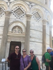 Group photo in front of the main entrance of the Tower of Pisa