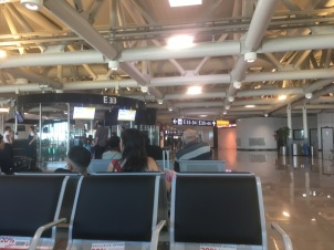 Waiting for flight, at the middle distance to the left you can see the clear-walled off area of the gate