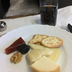 Snack of cheese and nuts, maybe wine too